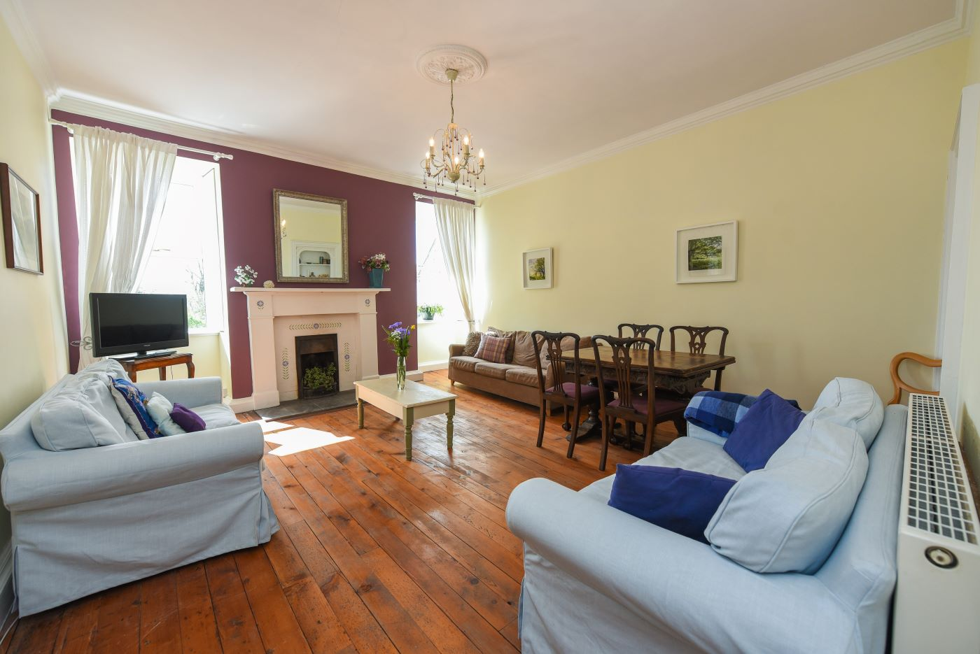 Comfy sofas and flat screen tv and extra dining in southfield's upstairs sitting room.