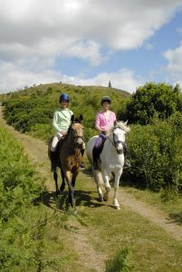 girls horse riding